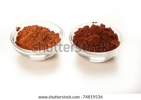 Comparison shot of dutch processed cocoa and natural cocoa powder - stock photo