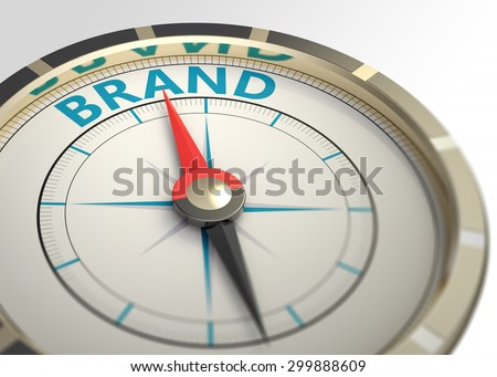 Compass and an arrow pointing to the word brand - stock photo