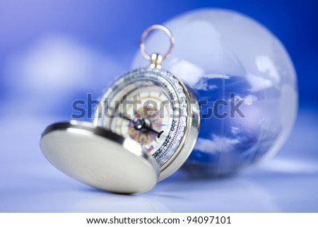 Compass and bluse sky - stock photo