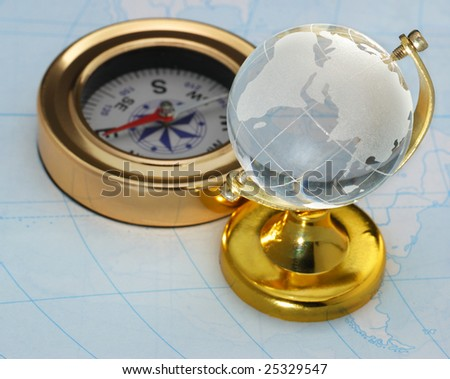 Compass and globe - stock photo