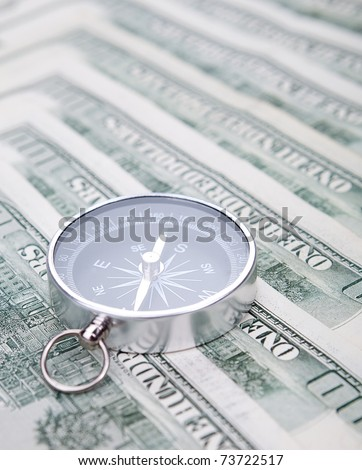 Compass and money - stock photo