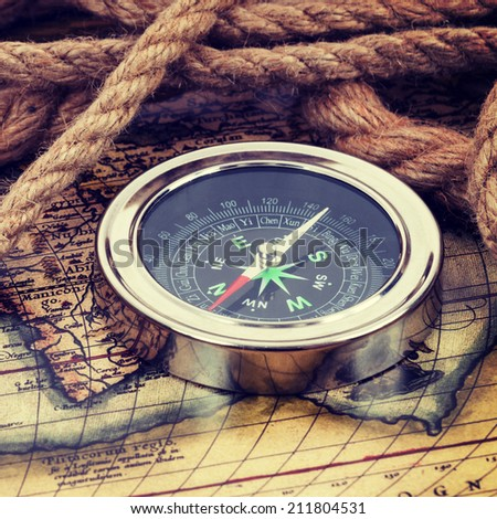 Compass and old map. The map used for background is in Public domain. Map source: Library of Congress. Country: Belgium Year: 1570. Author: Abraham Ortelius - stock photo