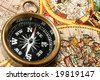 Compass and old world map macro composition - stock photo