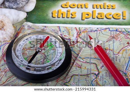 Compass and pencil on the map and guidances - stock photo