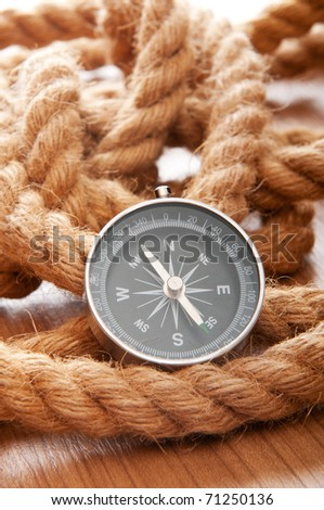 Compass and rope in travel and adventure concept - stock photo