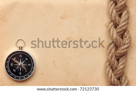 compass and rope on old paper - stock photo