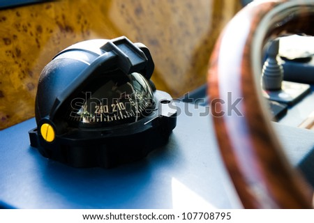 Compass and rudder on a yacht. - stock photo