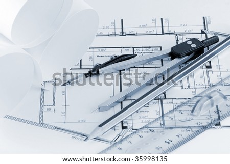 compass and ruler in the terms of office - stock photo