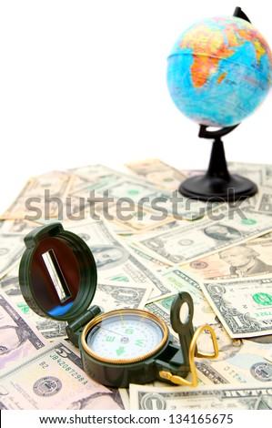 Compass and the globe on dollars. On a white background. - stock photo