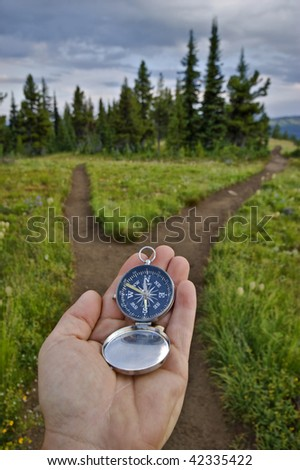 compass and trail junction - stock photo
