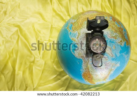 Compass at top of the globe - stock photo