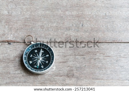 compass close-up on wood background - stock photo