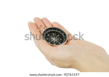 Compass in a hand isolated on the white - stock photo