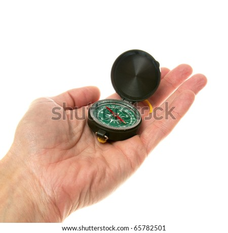 Compass in a mans hand isolated on the white - stock photo