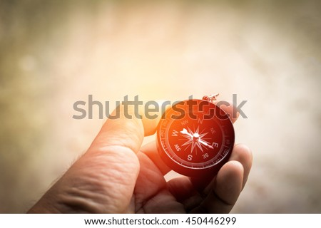 Compass in hand  - stock photo