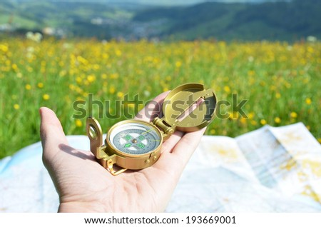 Compass in the hand - stock photo
