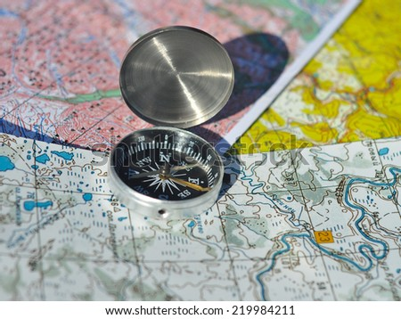 Compass, map. The magnetic compass is located on a topographic map.