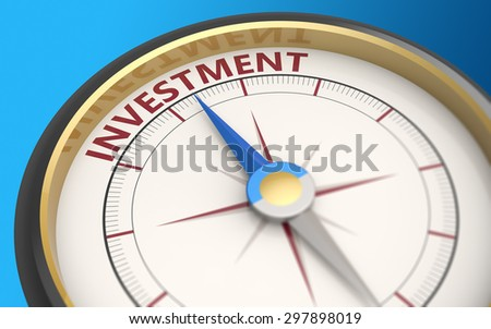 Compass needle pointing to the word investment - stock photo