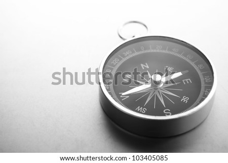 Compass on a gray gradient background, place for text - stock photo