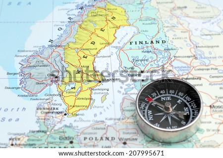 Compass on a map pointing at Norway Sweden and Finland, planning a travel destination in Scandinavia - stock photo