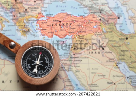 Compass on a map pointing at Turkey and planning a travel destination - stock photo