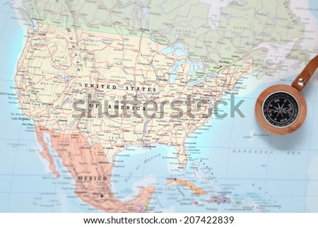 Compass on a map pointing at United States and planning a travel destination - stock photo