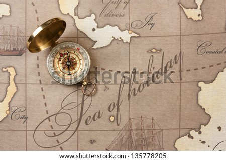 compass on a stylized map - stock photo