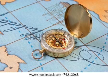 compass on a stylized map - stock photo
