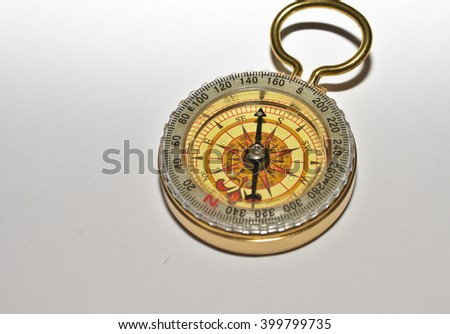 Compass on a white background. Photo of magnetic compass on white paper. - stock photo