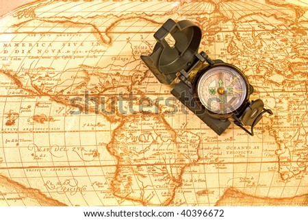 Compass on ancient world map - stock photo