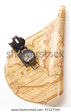 Compass on ancient world map isolated on white - stock photo