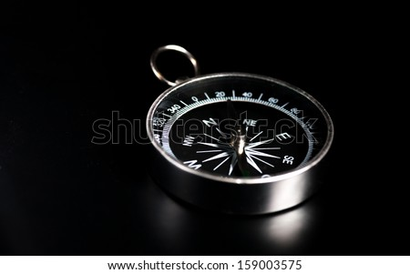 compass on  black board background and a lot od copy space - stock photo