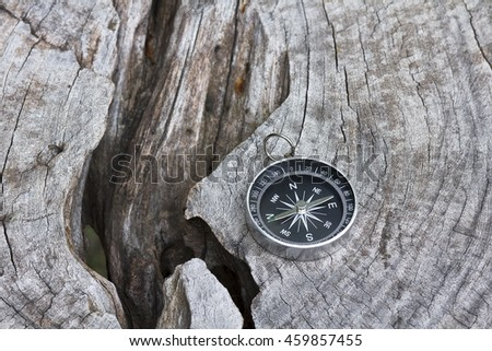 Compass on blurred old wood background - stock photo