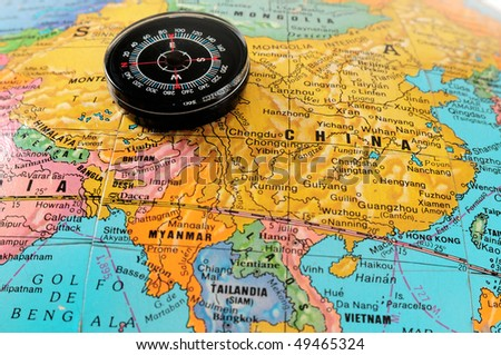 Compass on map. - stock photo