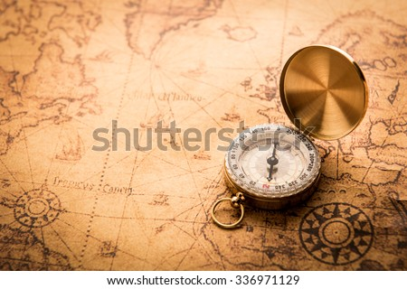 Compass on old map vintage style - stock photo