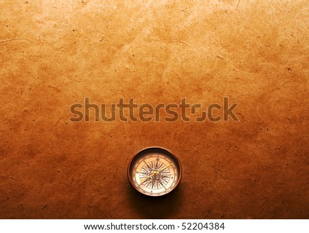 Compass on old paper background