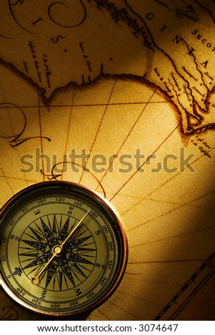 compass on old textured paper with copy-space - stock photo