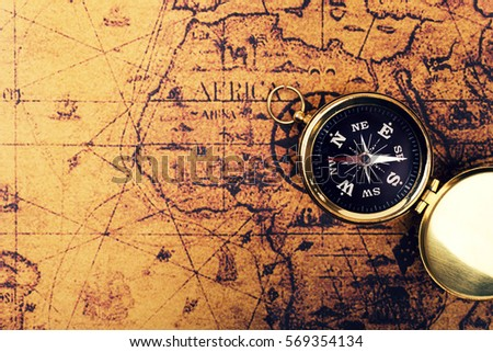 Compass on old vintage world map imagen de archivo stock 569354134 compass on old vintage world map with copy space gumiabroncs Choice Image