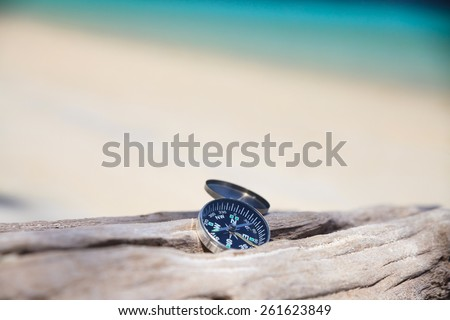 Compass on the beach - stock photo
