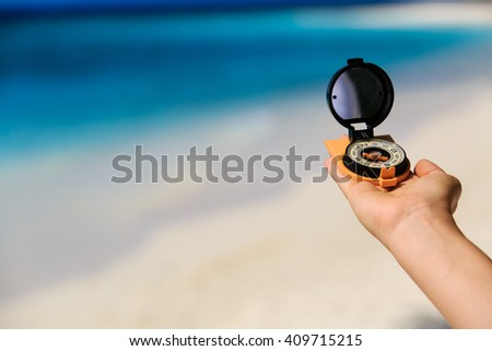 compass on the beach, travel concept - stock photo
