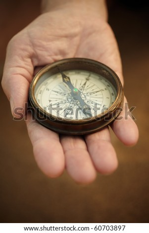 compass on the hand, selective focus,lens blur - stock photo