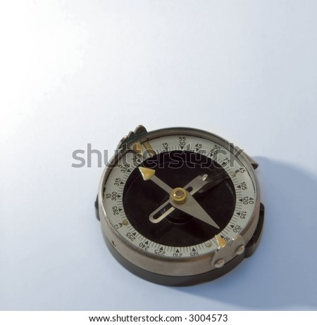 compass on the white background with blue lighting