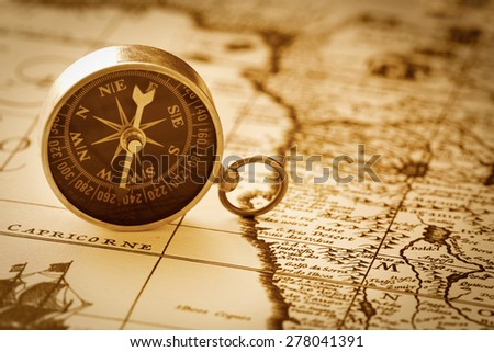 Compass on vintage map - stock photo
