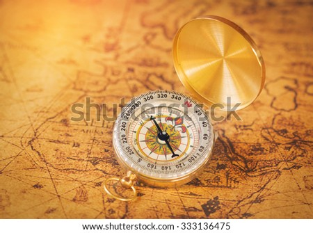 compass on vintage map background. - stock photo