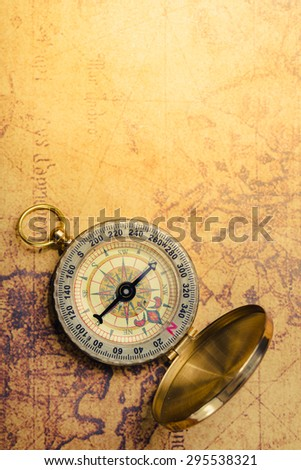 Compass on vintage map. Vintage filter. - stock photo