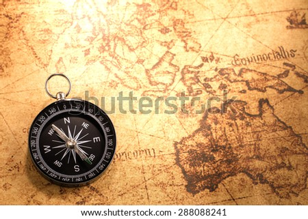 Compass on vintage map,Vintage stlye - stock photo