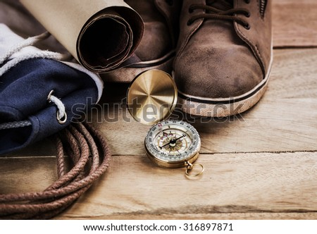 compass on vintage map with accessory to the Adventure. - stock photo