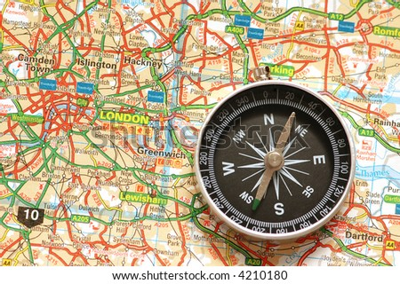 Compass over the map of UK  - London suburbs - stock photo