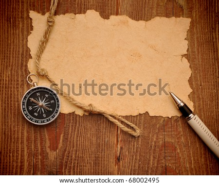 compass, pen and rope on grunge background - stock photo