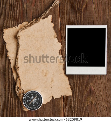 compass, rope and old photo on grunge background - stock photo